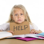 sweet little school girl holding help sign in stress with books and homework